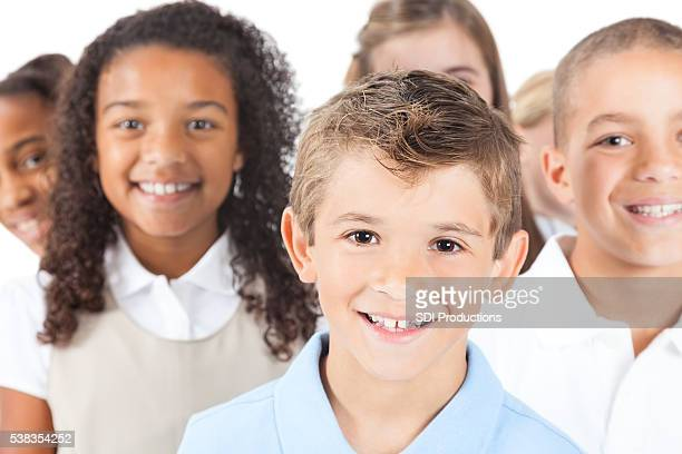 Smiling elementary aged boy in blue