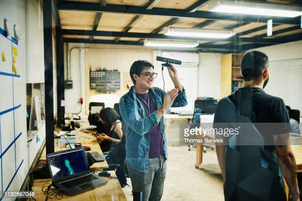 smiling engineer creating 3d scan of coworker in design studio - 3d scanning stock pictures, royalty-free photos & images