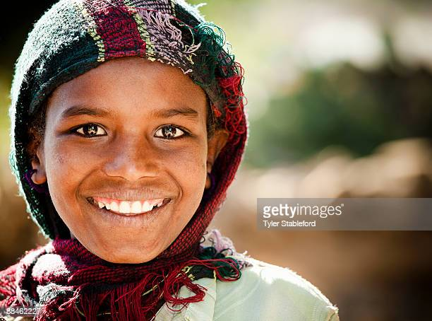 smiling ethiopian girl with shawl. - ethiopia stock pictures, royalty-free photos & images