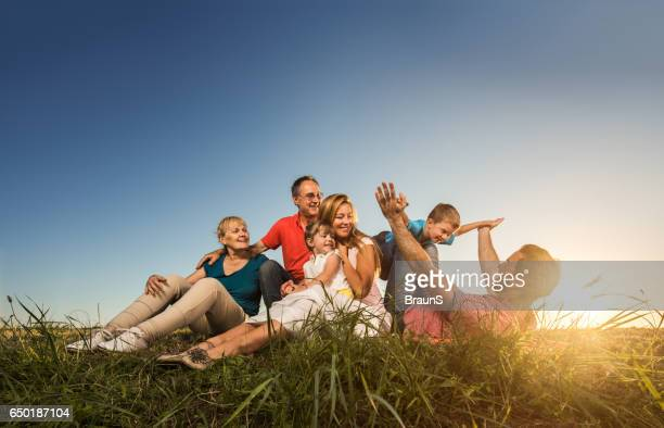 Smiling extended family spending their day together in nature.