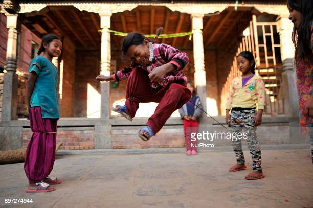 Smiling face of Nepalese girls enjoys by playing Jump rope at Bungamati on Friday December 22 2017