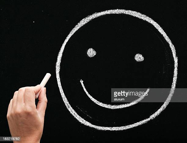 smiling face on blackboard