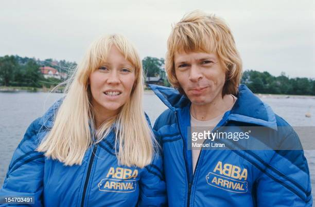 Smiling face plane of Bjorn Ulvaeus and Agnetha Faltskog his wife posing side by side Both wear a blue anorak with ABBA written above and 'Arrival'...
