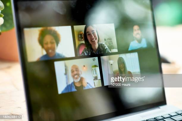 smiling faces on laptop screen during video call - internet stock pictures, royalty-free photos & images
