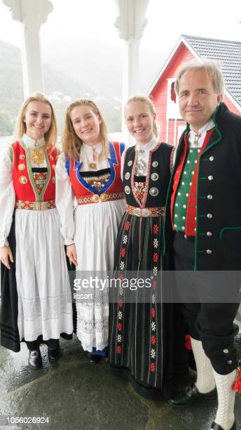 smiling family group in traditional bunad of norway - traditionally norwegian stock pictures, royalty-free photos & images