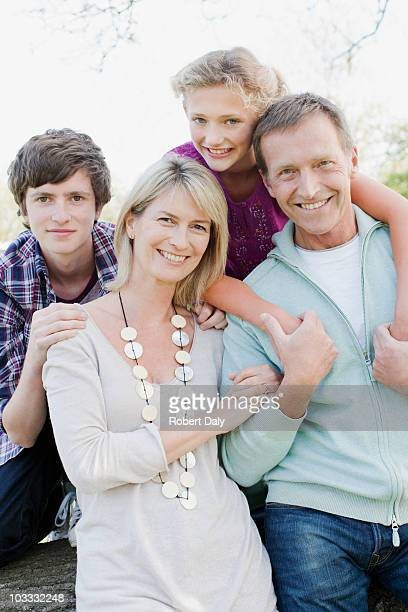Smiling family hugging outdoors