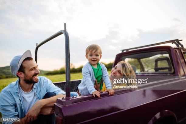 Smiling family in a pick-up truck
