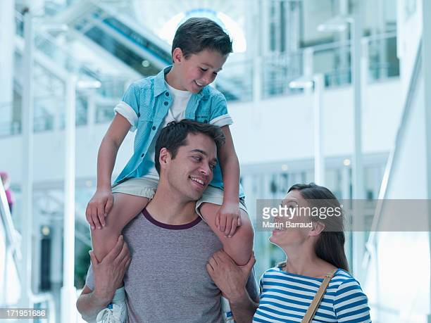 Smiling family in shopping mall