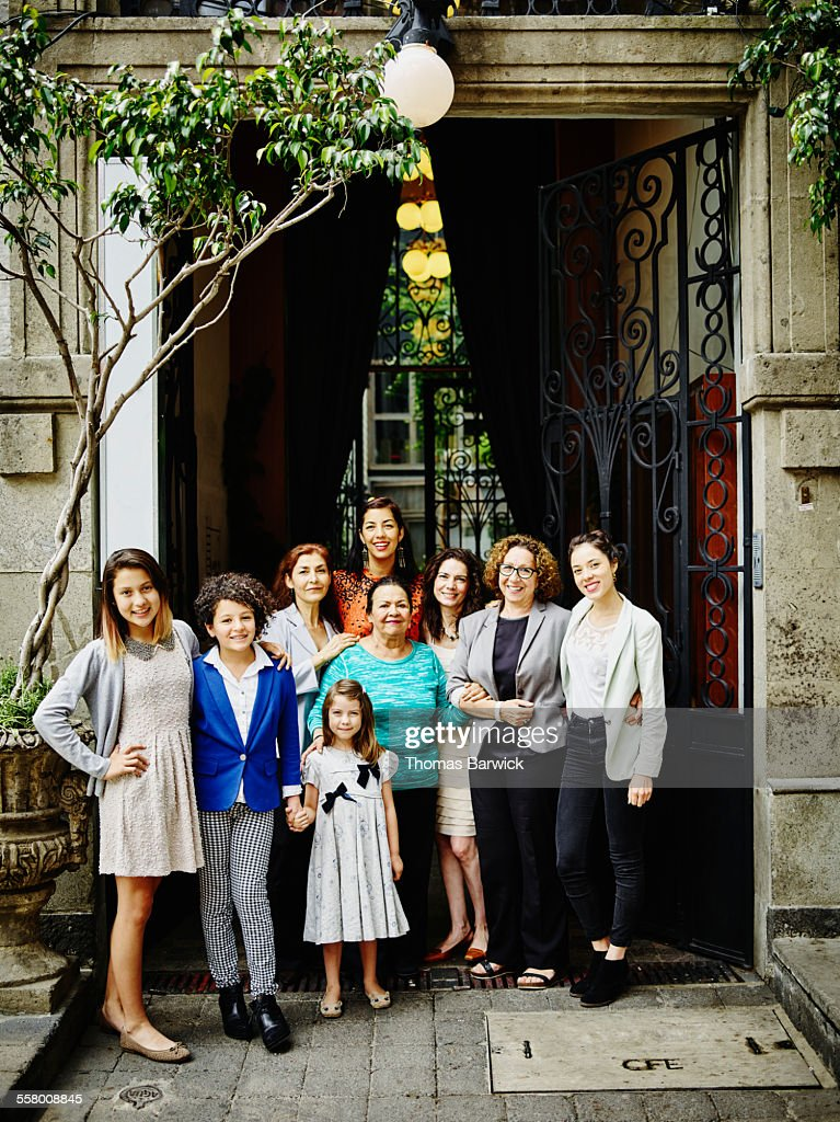 Smiling family of women standing together : Stock Photo