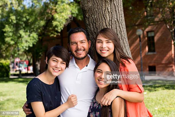 Smiling father and daughters
