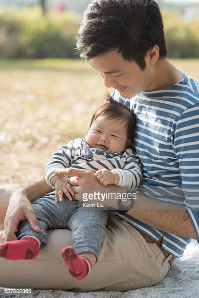 Smiling father & baby boy