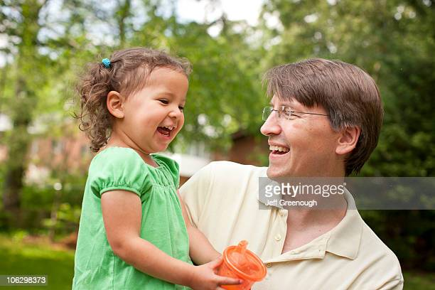 smiling father holding daughter - blacksburg stock pictures, royalty-free photos & images