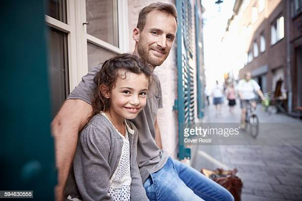 Smiling father with daughter outdoors
