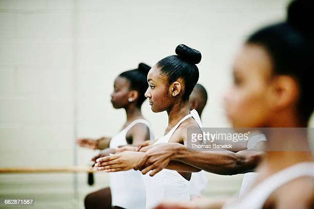 smiling female ballet dancer dancing with partner - rehearsal stock pictures, royalty-free photos & images