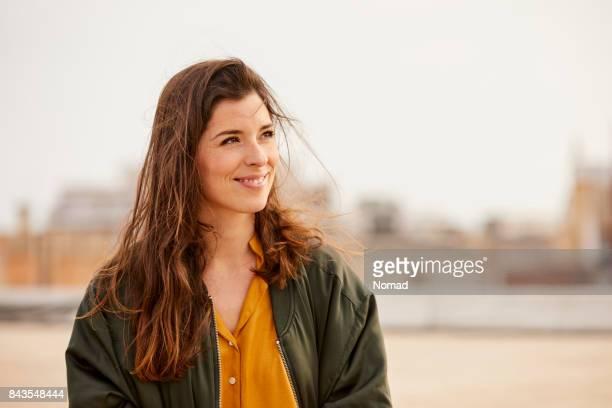 Smiling female brunette at rooftop