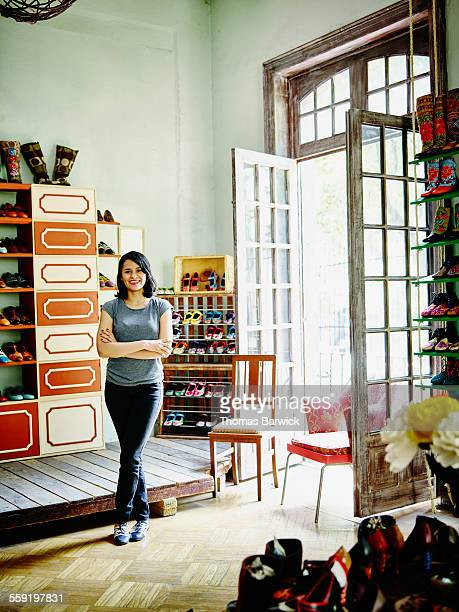 Smiling female business owner in shoe shop