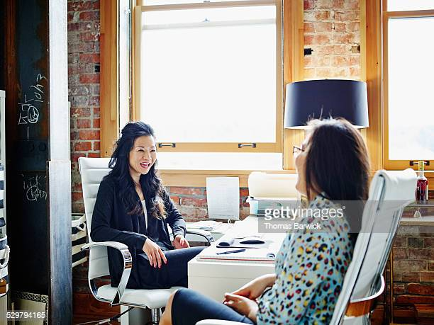 Smiling female business owners discussing project