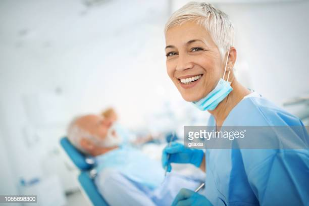 smiling female dentist. - dentist stock pictures, royalty-free photos & images