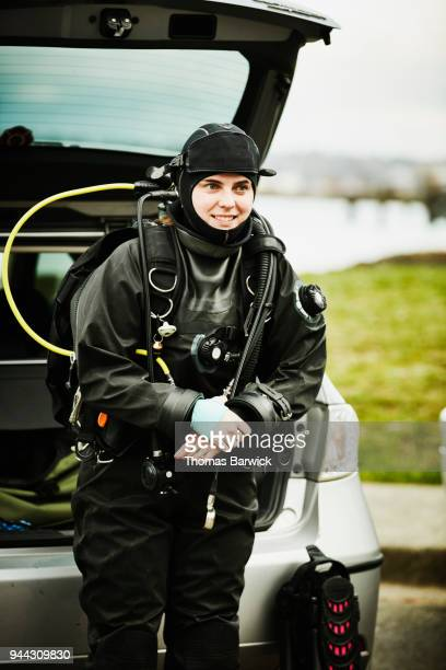 Smiling female diver prepared for open water dive