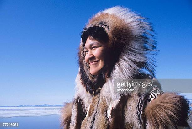 smiling female eskimo - inuit stock pictures, royalty-free photos & images
