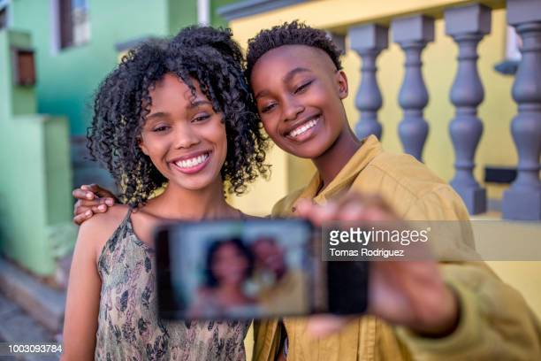 Smiling female friends taking a selfie outdoors