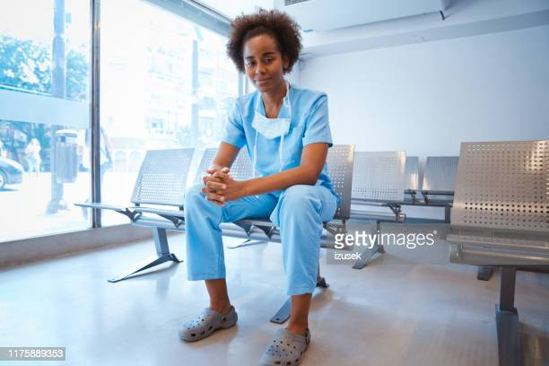 smiling female healthcare worker at waiting room - outpatient care stock pictures, royalty-free photos & images