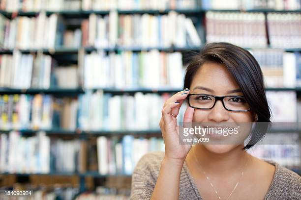 Smiling female in glasses at the library