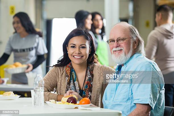 smiling female picture taken during volunteering meals - depression bread line stock pictures, royalty-free photos & images