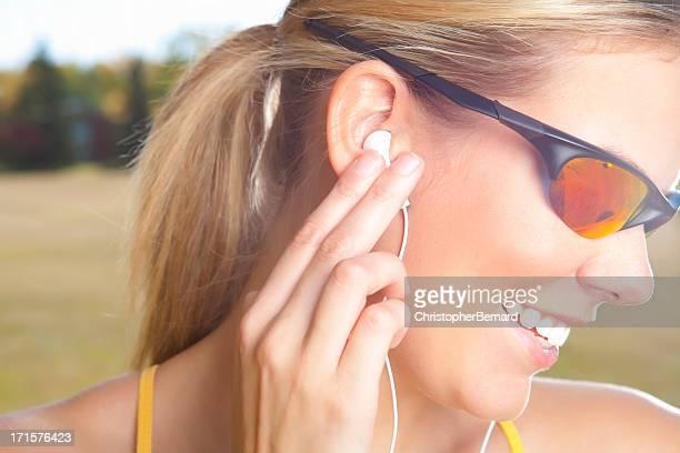 Smiling female runner with sunglasses