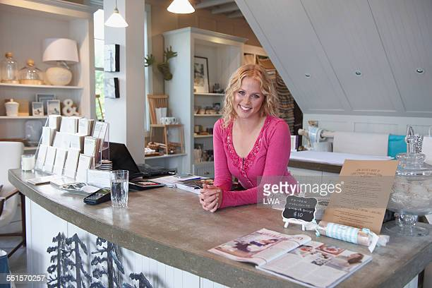 smiling female small business owner - glass magazine stock photos and pictures