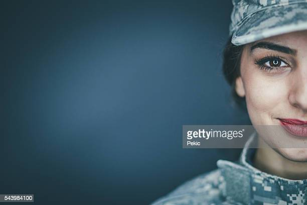 smiling female soldier - army soldier stock photos and pictures