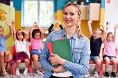 Smiling female teacher in the preschool