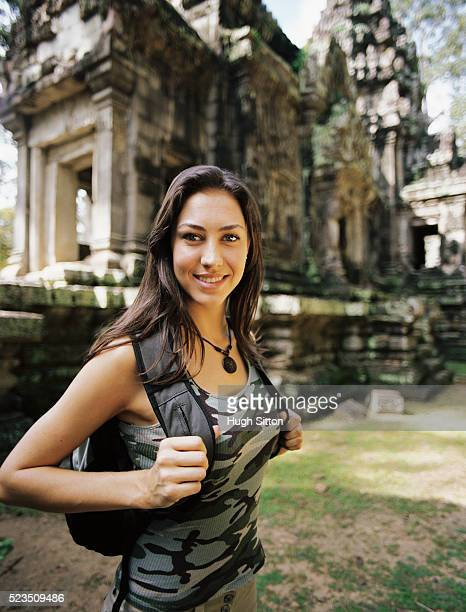 smiling female tourist at old temple - hugh sitton stock pictures, royalty-free photos & images