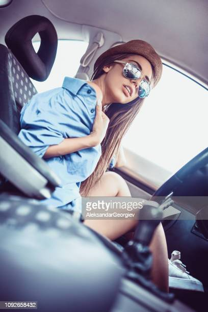 Smiling Female With Sunglasses Posing In Beautiful Car