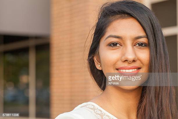 smiling female young college student of indian ethnicity - indian college girls ストックフォトと画像