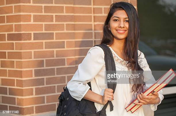 smiling female young college student of indian ethnicity - indian college girls stockfoto's en -beelden