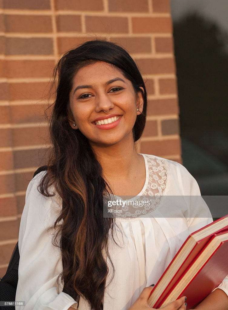 Smiling female young college student of Indian ethnicity : Stock Photo