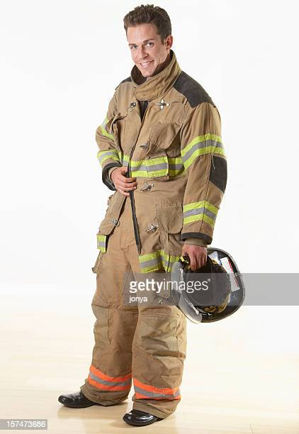 smiling firefighter - fire protection suit stock photos and pictures