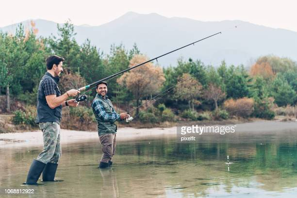 smiling fishermen - fishing industry stock pictures, royalty-free photos & images