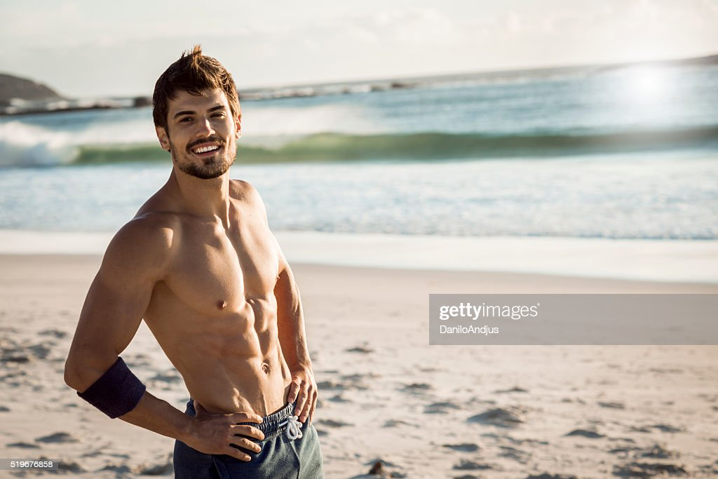 smiling fit man relaxing after workout : Stock Photo