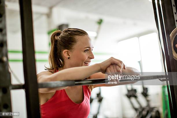 Smiling fitness young woman in the gym