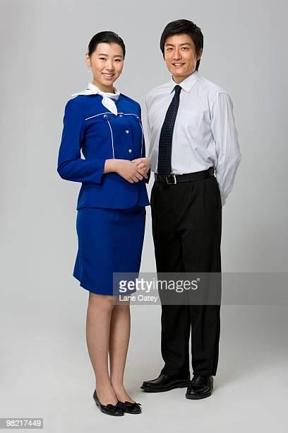 smiling flight attendant - よそいきの服 ストックフォトと画像