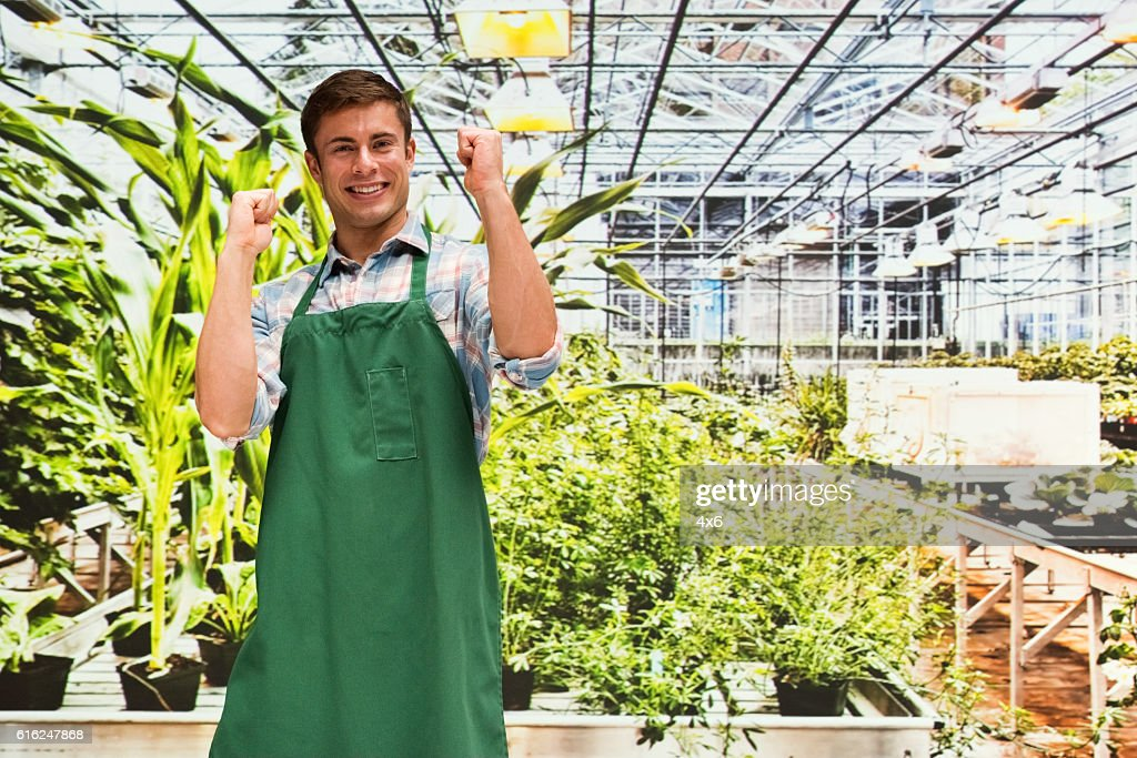 Smiling florist cheering in greenhouse : Stock-Foto