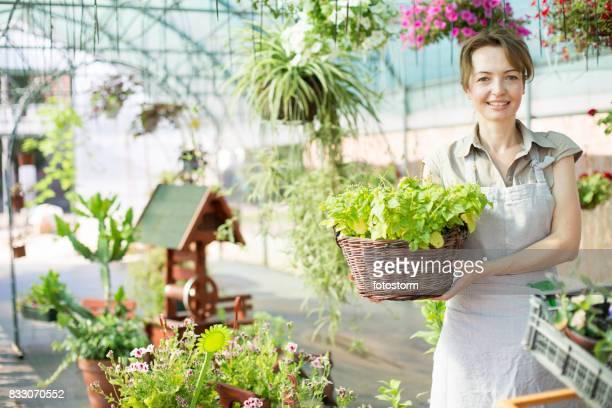 Smiling florist in flower shop