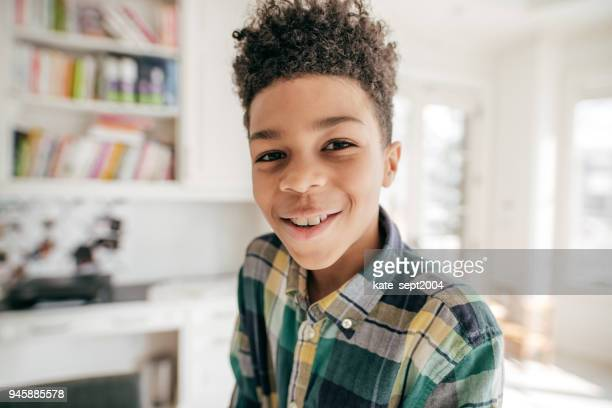 smiling for a photo - pre adolescent child stock pictures, royalty-free photos & images