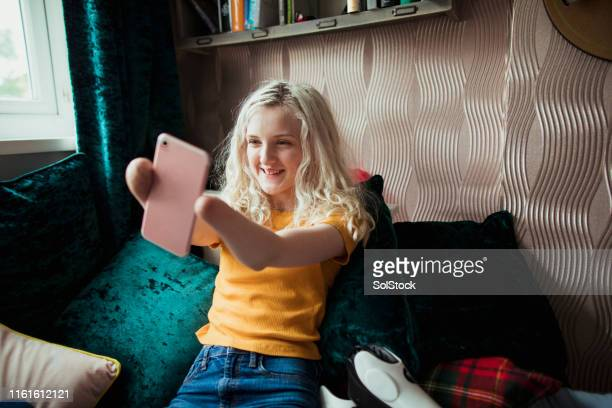 smiling for a selfie - amputee girl stock pictures, royalty-free photos & images