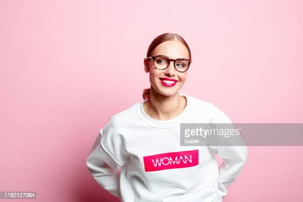 smiling friendly woman in a white blouse - pink blouse stock pictures, royalty-free photos & images