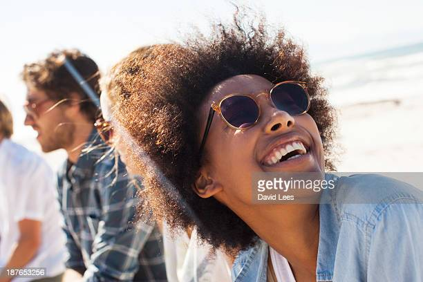 smiling friends at beach - candid beach stock photos and pictures