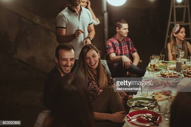 Smiling friends at the dinner party