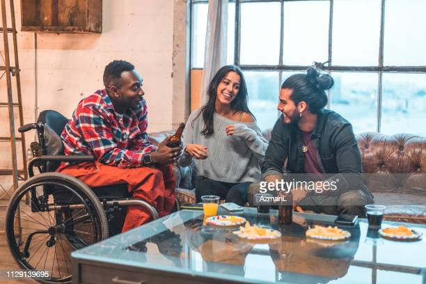 Smiling friends enjoying drinks in party at home